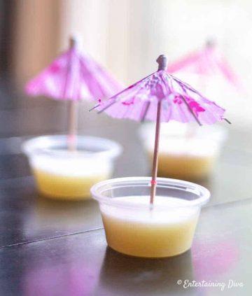 white pina colada jello shot with cocktail umbrella