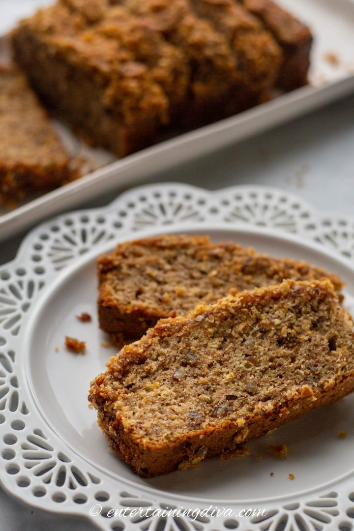 Two slices of classic banana nut bread with streusel topping on a plate