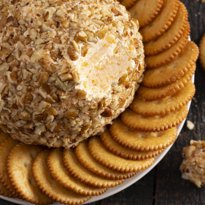 triple cheese ball with crackers on a plate