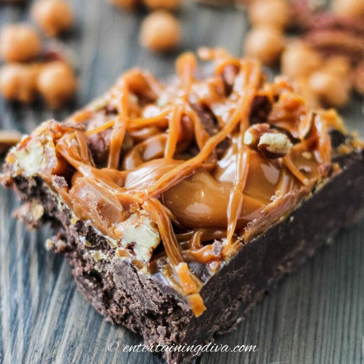close up of chocolate, caramel pecan turtle fudge