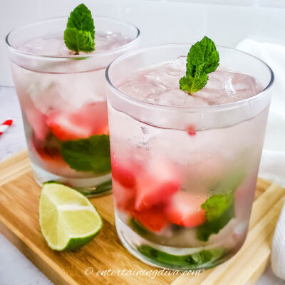 strawberry mint mojitos in glass with ice and lime