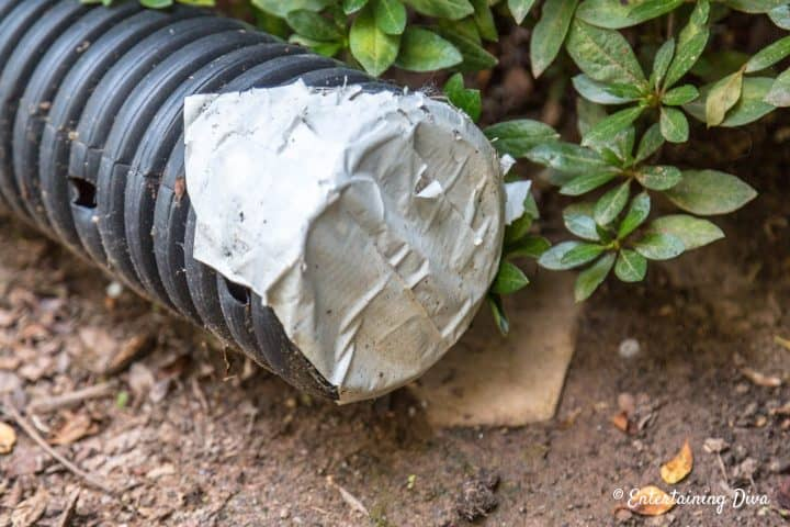 Plastic drainage pipe with duct tape on one end