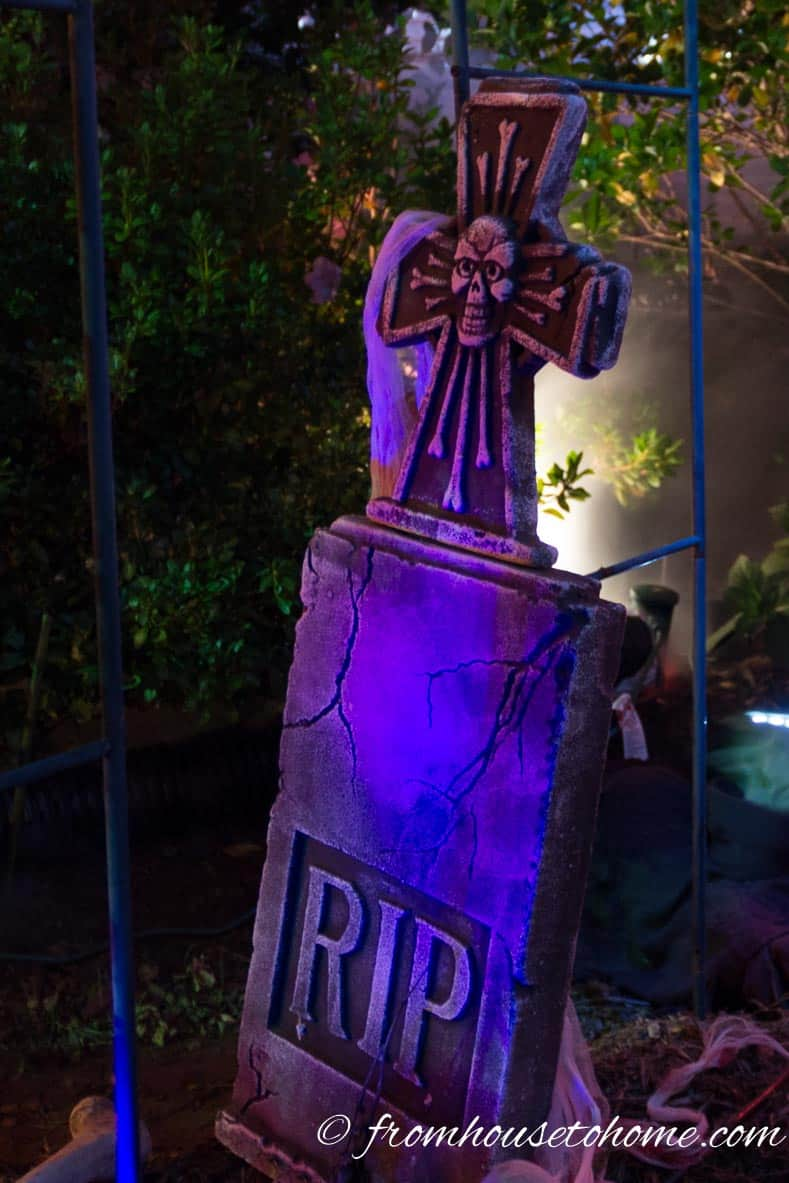Halloween tombstone lit with a blue floodlight