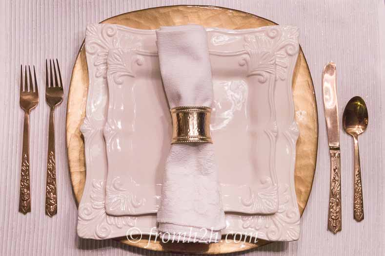 A gold charger that matches the cutlery adds a little extra sparkle   5 No-Fail Ways to Create Beautiful Table Settings