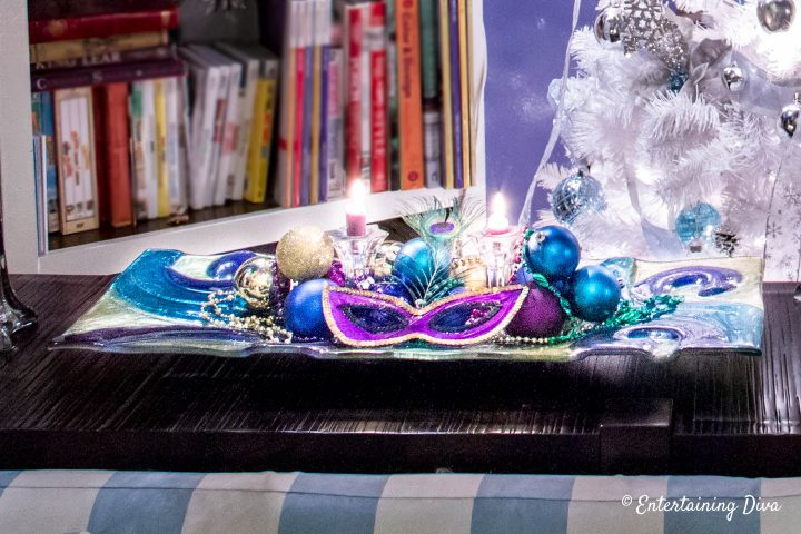 Mardi Gras table centerpiece with mask and beads