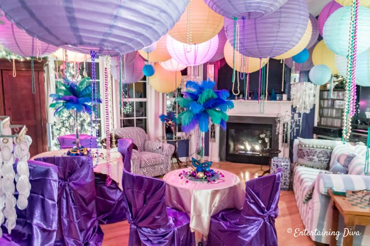 Mardi Gras party room decorations with beads and paper lanterns