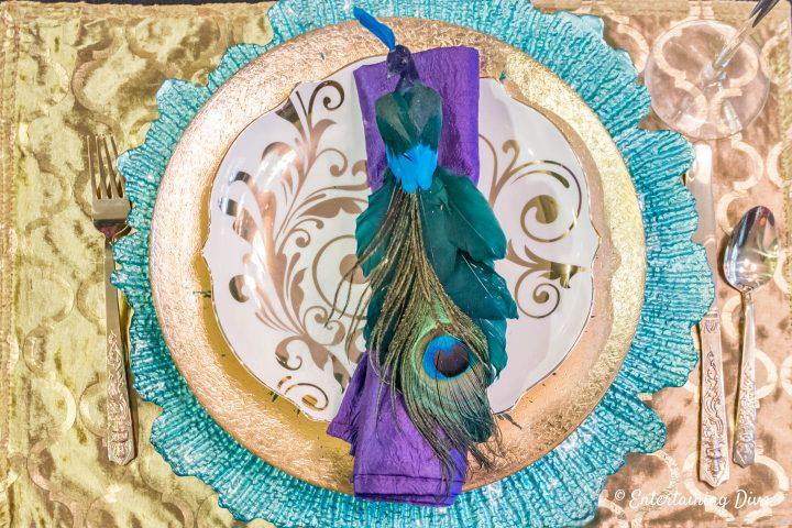 Mardi Gras tablescape with peacock napkin ring