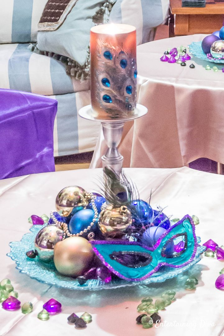 Mardi Gras table decorations with mask, ornaments and beads