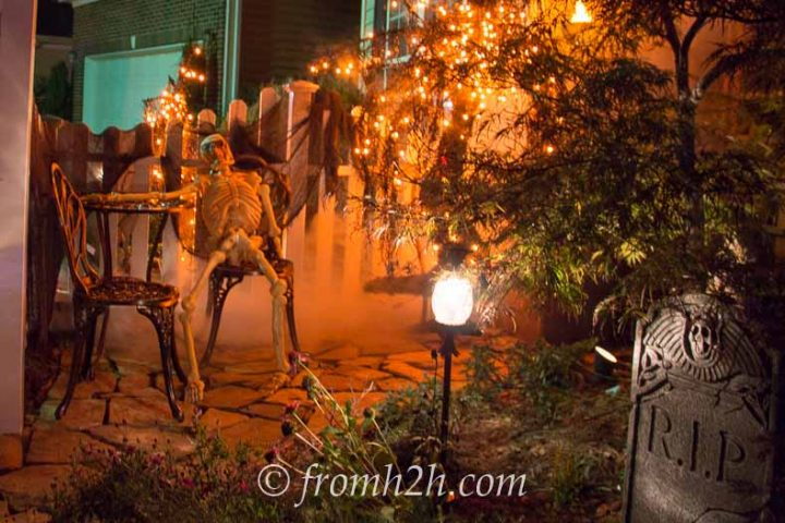 Halloween graveyard with orange lights and fog