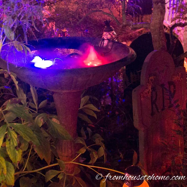 Halloween outdoor lighting with two misters in the bird bath