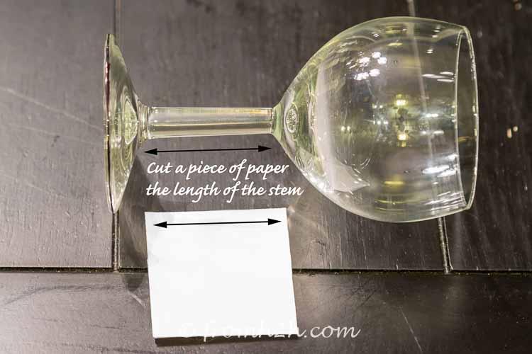 Cut paper the length of the stem | DIY Santa Wine Glasses