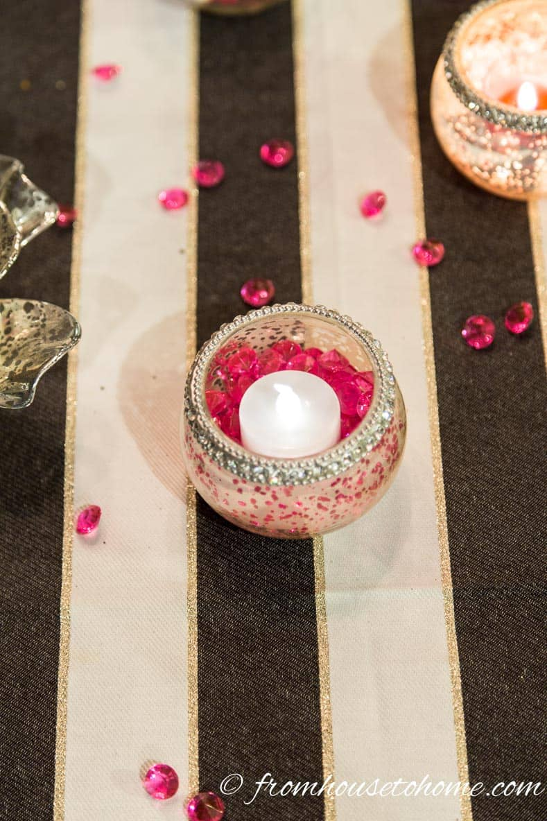 Using a timer-operated flameless candle makes sure they turn on when you need them   How to create a romantic Valentine's Day table setting