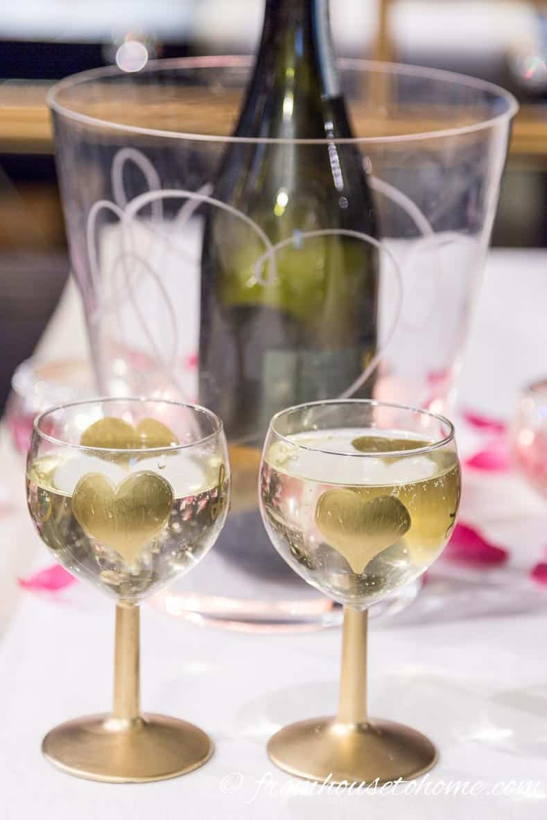 Using an ice bucket with the heart motif is an extra added touch   How to create a romantic Valentine's Day table setting