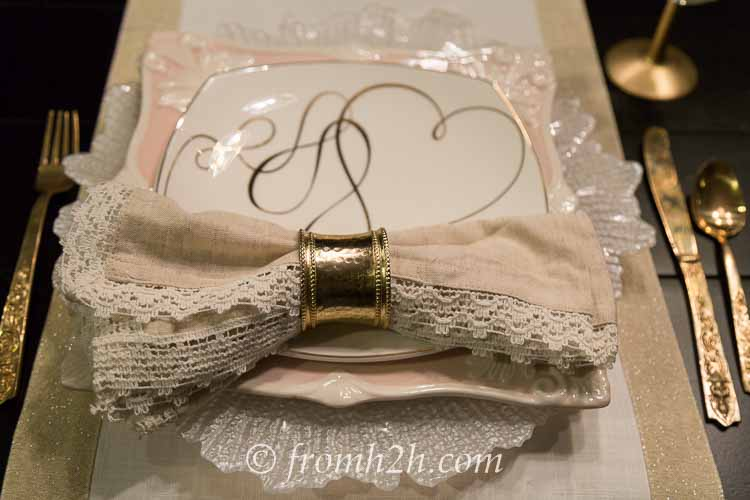 The gold napkin ring ties in with the other gold accents on the table   How to create a romantic Valentine's Day table setting