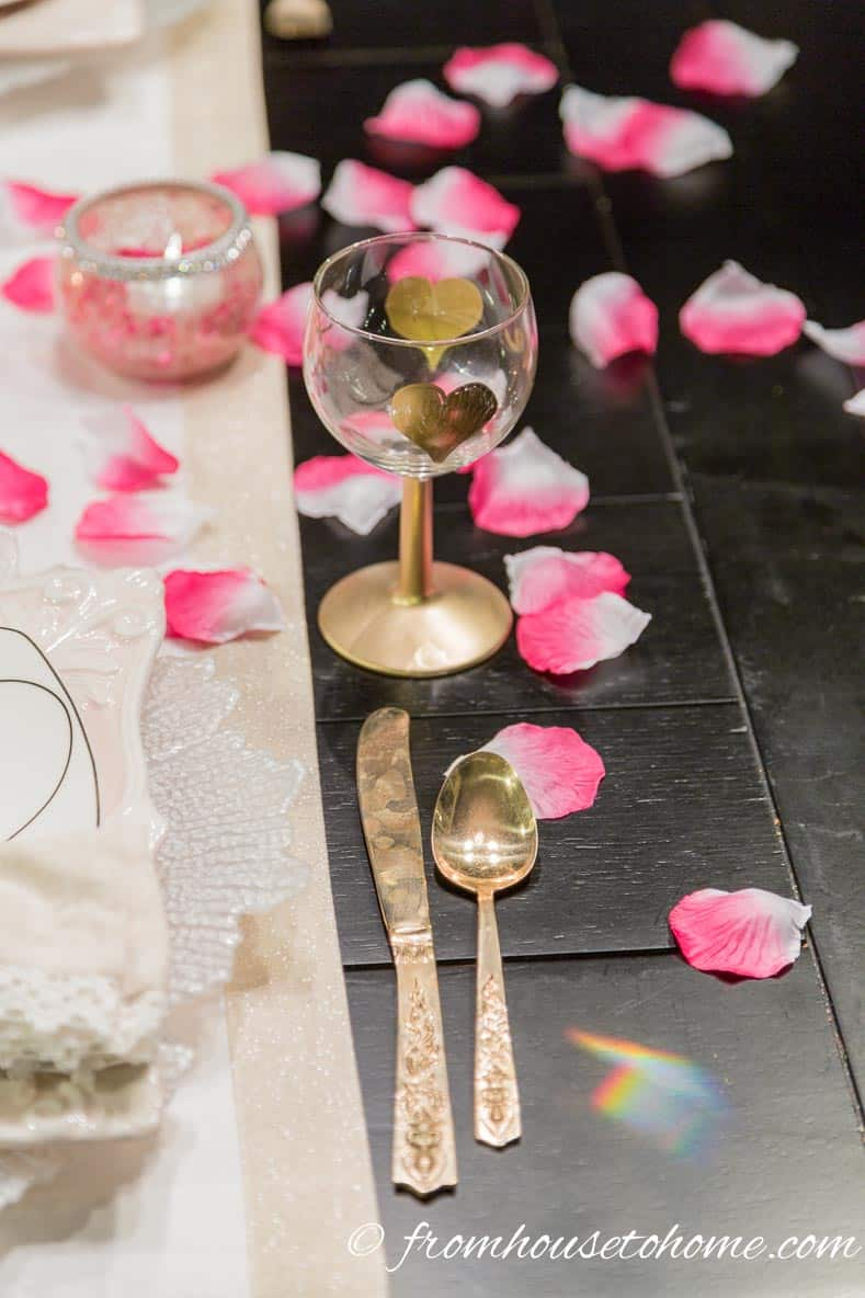 Wine glass with rose petals   How to create a romantic Valentine's Day table setting