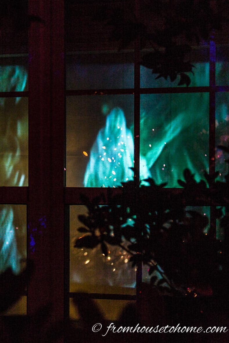 Halloween ghost projected in a window