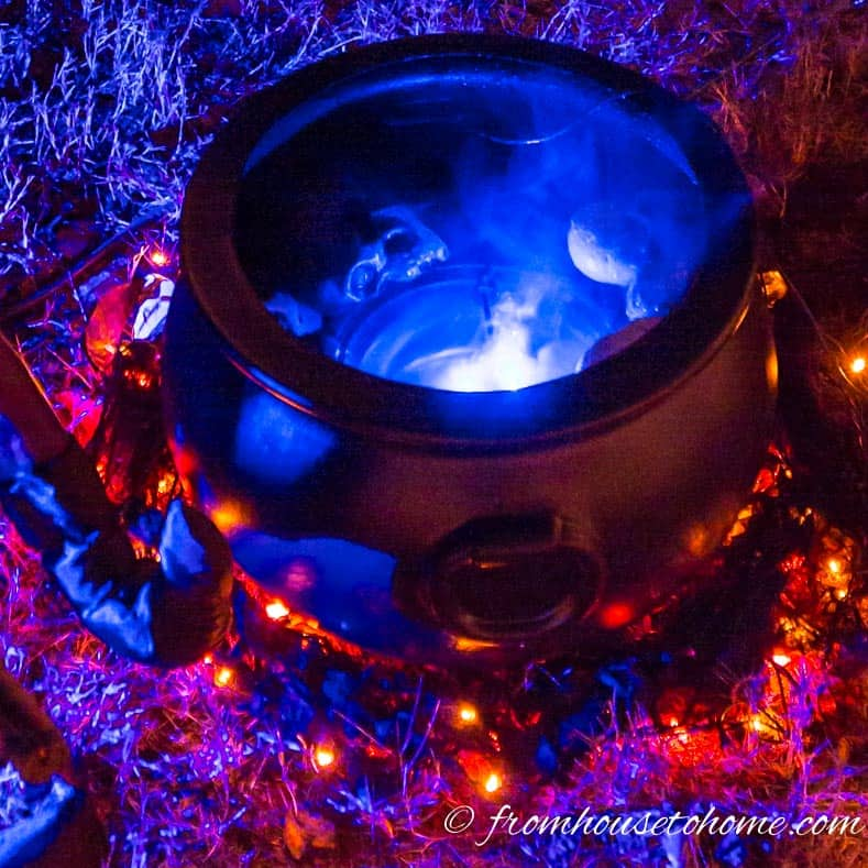 DIY witches cauldron Halloween lighting effect using a mister and orange string lights