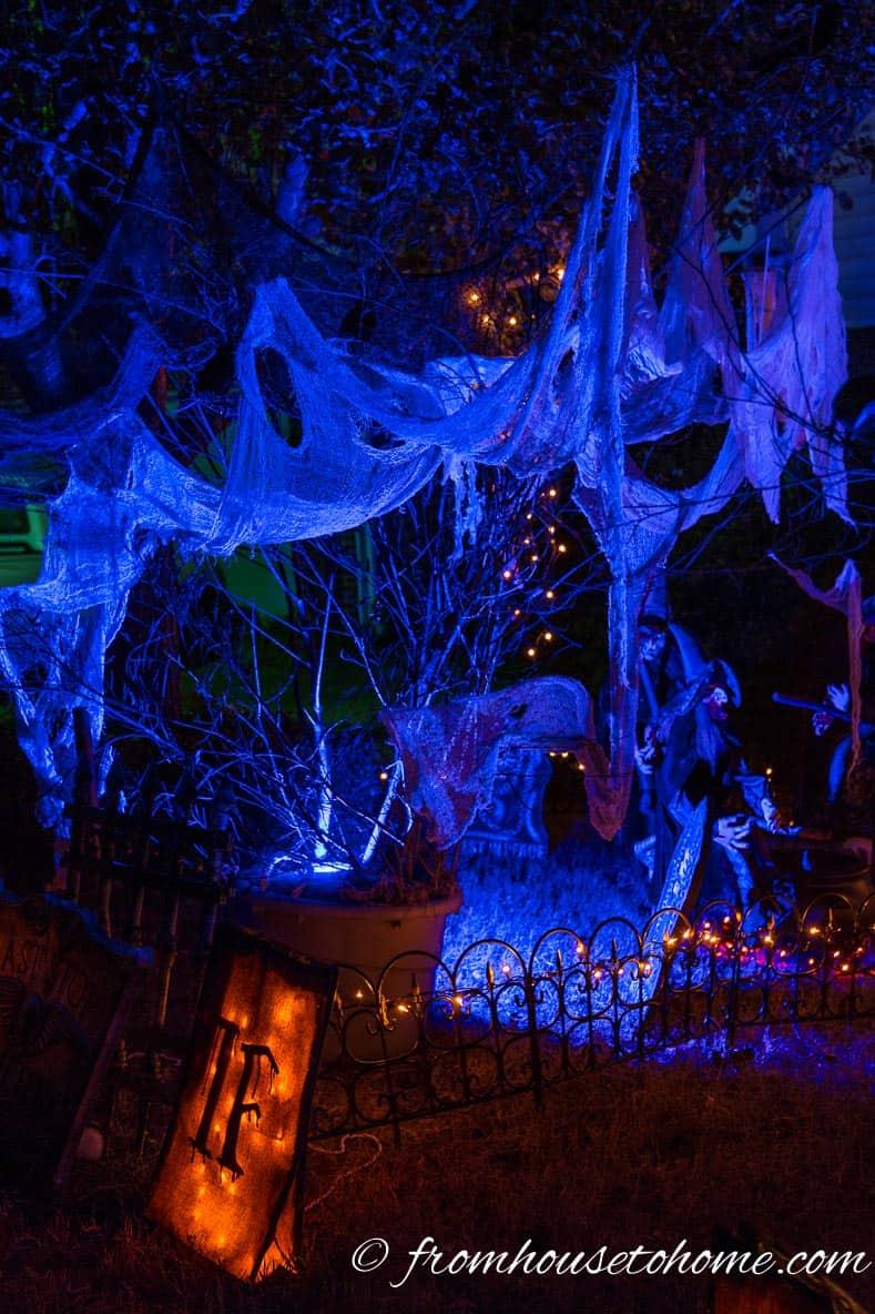 Spooky blue light in Halloween outdoor yard display