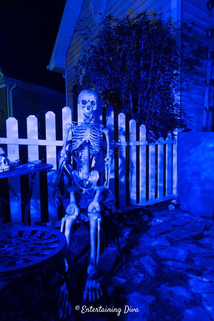 Halloween skeleton highlighted with a blue flood light