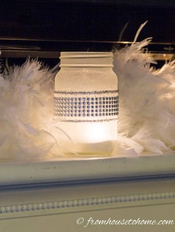 Frosted glass candle holder on mantle