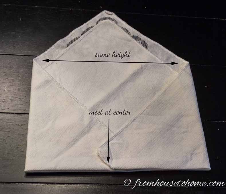 Step 4: Fold the right corner half way over | Easy and Free Valentines Day Table Decor Folded Napkin Envelope | I don't usually do a lot of decorating for Valentine's Day but I do like to do something elegant for the table. These folded napkin envelopes with a DIY heart place card are really easy (and inexpensive!), add a bit of Valentine's Day decor to the table but aren't too much.