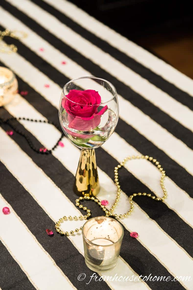 Black and gold Mardi Gras beads add some fun to the table | Kate Spade Inspired Table Setting
