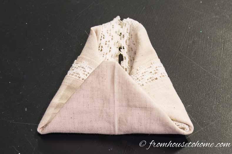 Fold up the bottom of the napkin