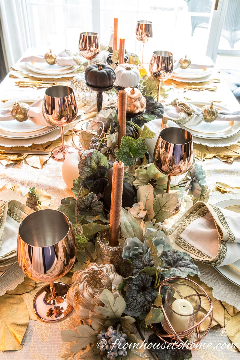 Copper fall table centerpiece with candles and wine glasses