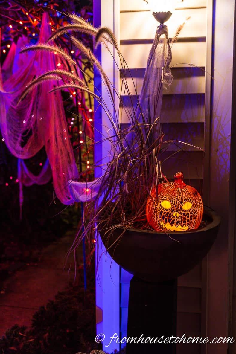 Halloween outdoor pumpkin light in a planter