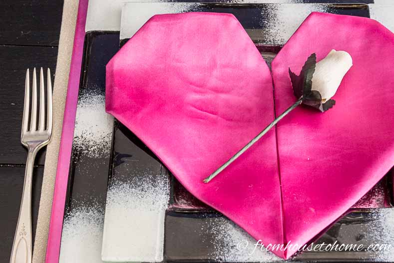 Valentine's Day heart-shaped folded napkin with white rose
