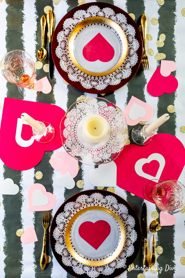 Red, white and pink paper hearts on a Valentine Day table setting
