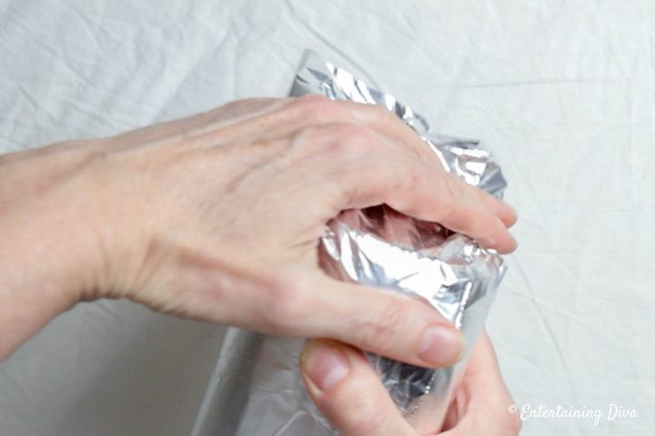 Fold the foil over the bottom of the mason jar