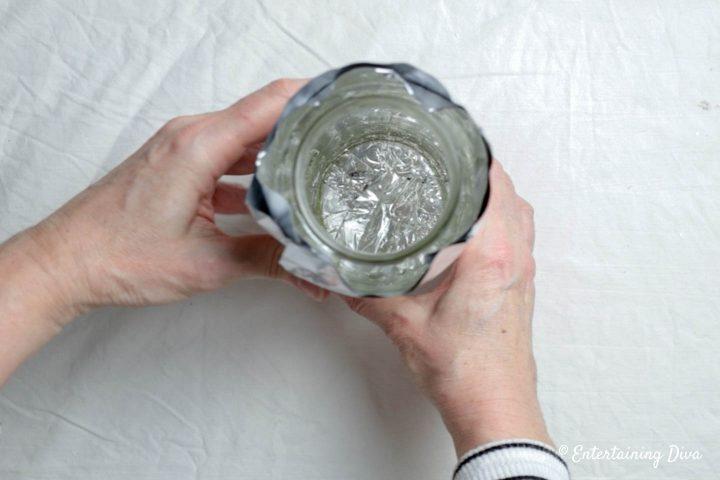 The large jar inside the foil mold