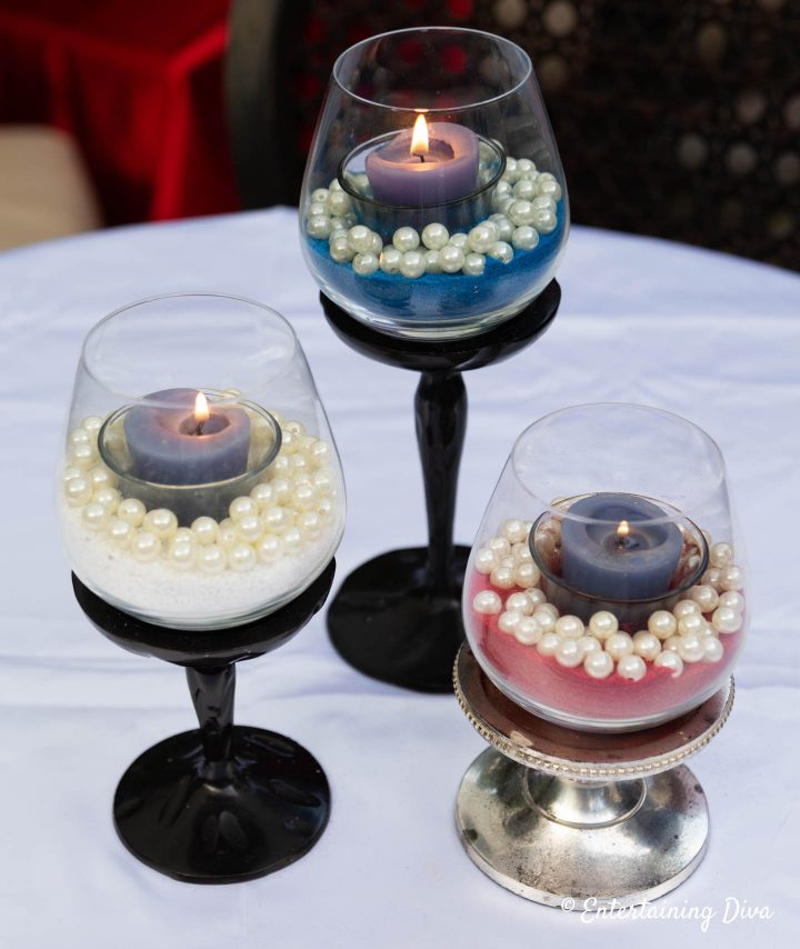 Three sand and pearls 4th of July candles made with red sand, white sand and blue sand