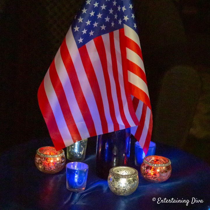 Red, white and blue flameless tealights around a small American flag