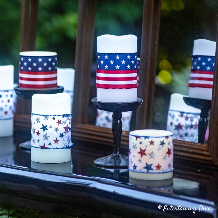 Flamless pillar candles wrapped in red, white and blue 4th of July ribbons