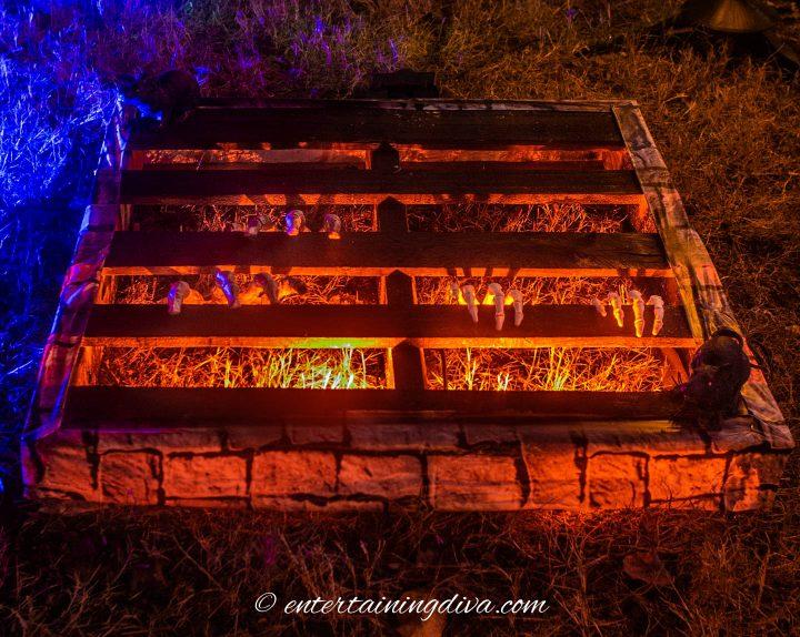 Halloween underground crypt lit with an orange spot light.