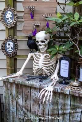 A skeleton in an outdoor Halloween display