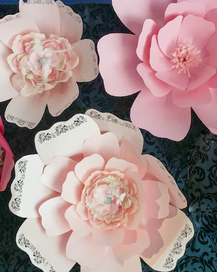 DIY giant paper flowers hung on a wall