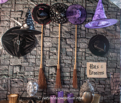 Witches party theme decor with witch hats and broomsticks