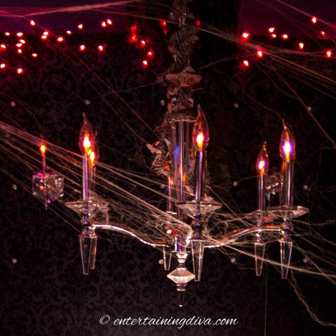 Chandelier with fake spider webs